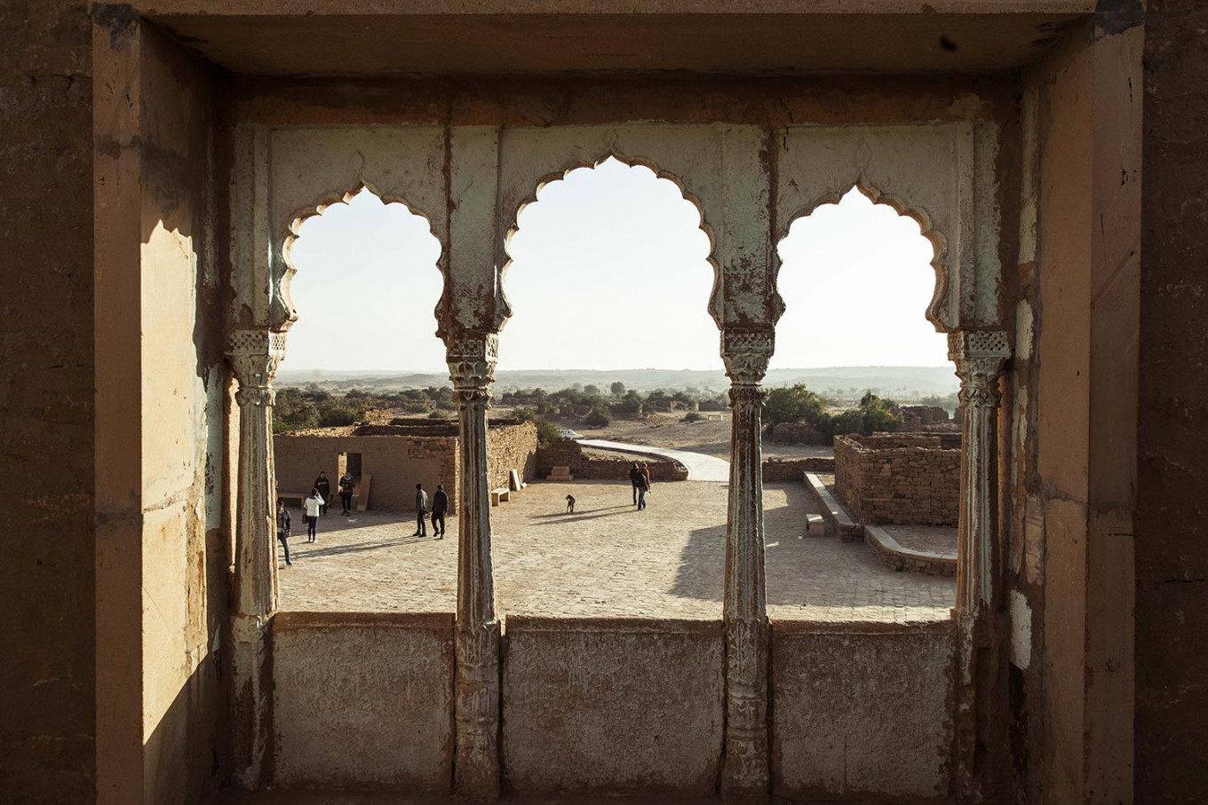 A group of tourists explores Kuldhara, an abandoned village built in the 13th century. JP/Irene Barlian