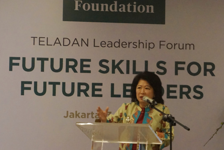 Mari Elka Pangestu,  a senior economist and former trade minister, gives a presentation during the Teladan Leadership Forum at the Tanoto Foundation's office in Central Jakarta on July 3.