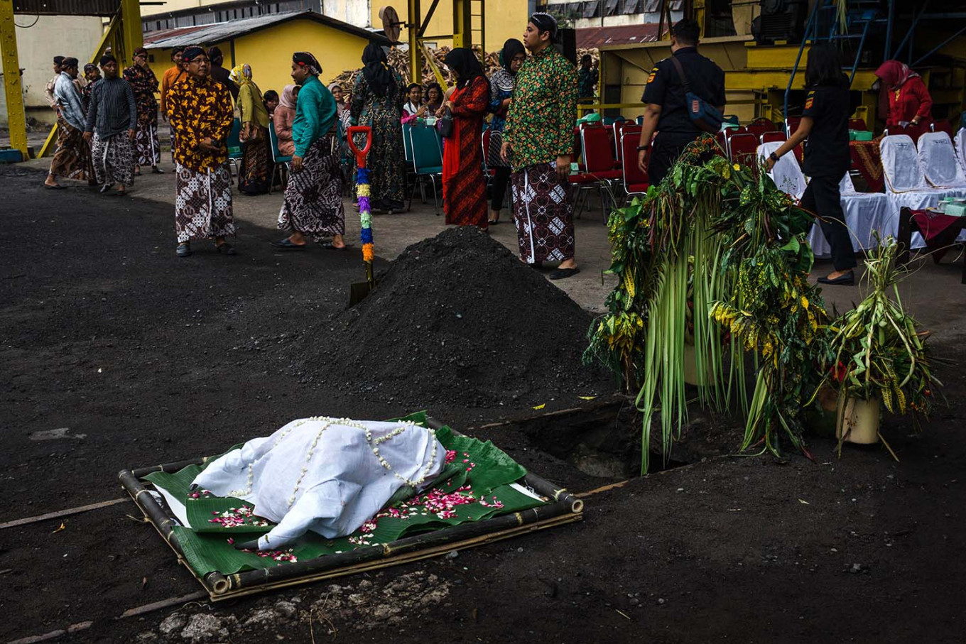 A buffalo head, covered with a white cloth and rose petals, is to be buried in front of the milling station. JP/Anggertimur Lanang Tinarbuko