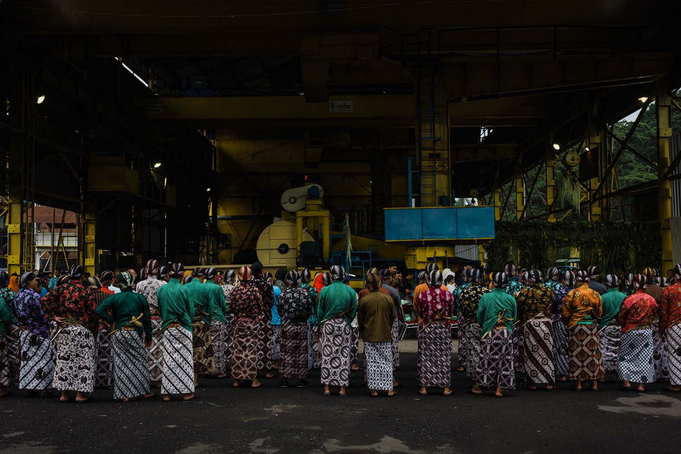 Employees of the Madukismo Sugar Factory dress in traditional Javanese attire and stand in front of the milling station. JP/Anggertimur Lanang Tinarbuko