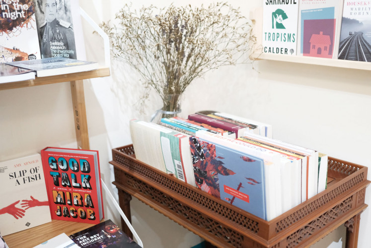 A corner at Transit Bookstore. The book on the front is 'Indigenous Species' by Khairani Barokka, a poetry book, written in English and published by the Tilted Axis Press.