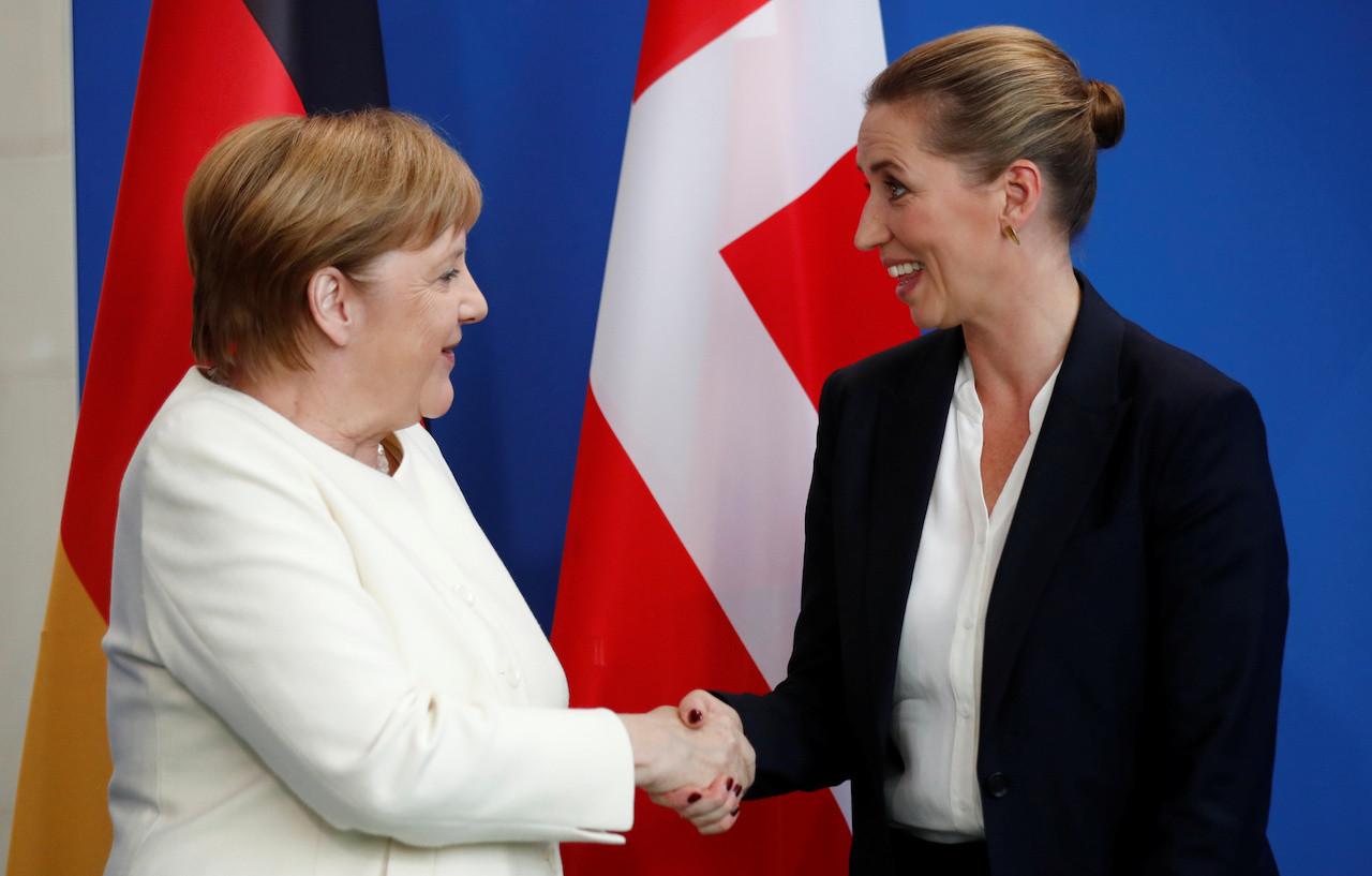 Merkel's shaking episodes fuel debate about German power handover