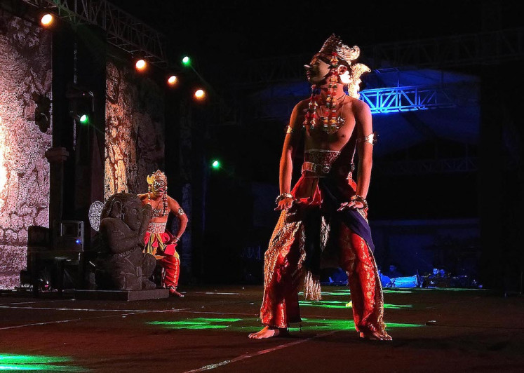 The 'Kutai' mask dance, a traditional dance of Kutai Kartanegara sultanate of East Kalimantan, is performed by the Sangkoh Piatu Foundation of Tenggarong, East Kalimantan, at the 2019 Archipelago Panji Festival in the Panataran Temple Amphitheater in Blitar, East Java, on July 9, 2019.