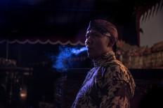 Puppeteer Ki Seno breathes smoke moments before he begins his performance. JP/Tyler Blodgett