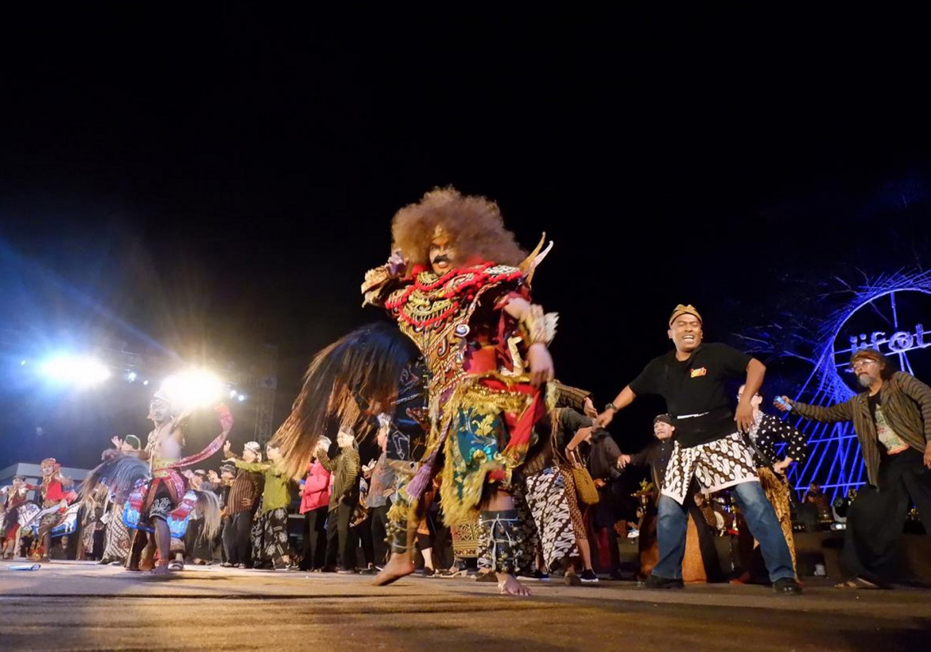 "The ""topeng ireng"" dance takes place at Temanggung town square on July 14."