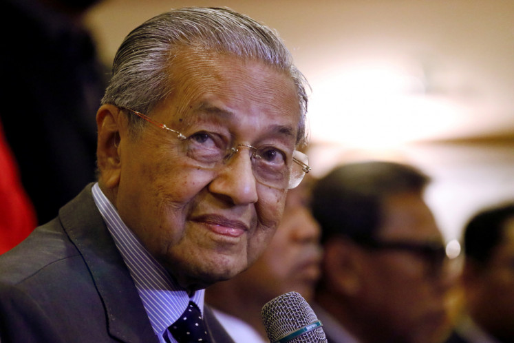Mahathir resigns but outcome of Malaysia power struggle unclear