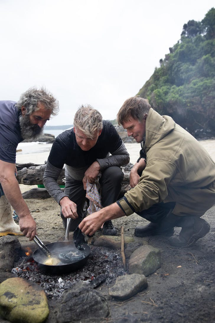 Rarely seen: Chef Gordon Ramsay (center) learns how to cook paua, a kind of abalone only found in New Zealand, from fishermen Fluff (left) and Zane.