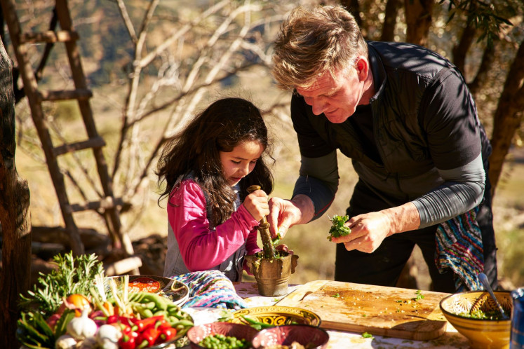 On the go: Gordon Ramsay learns traditional culinary methods in Morocco with assistance from his 9-year-old daughter.