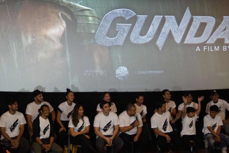 Director Joko Anwar (middle) and the cast of 'Gundala' during a press conference on Saturday in Central Jakarta.