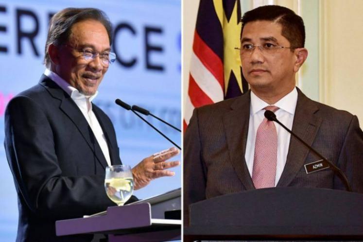 Azmin, Zuraida sacked from party of Malaysia's Anwar Ibrahim