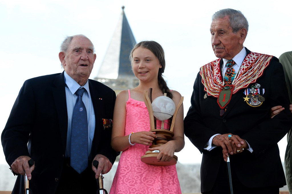 Teenage climate campaigner Thunberg honored in France