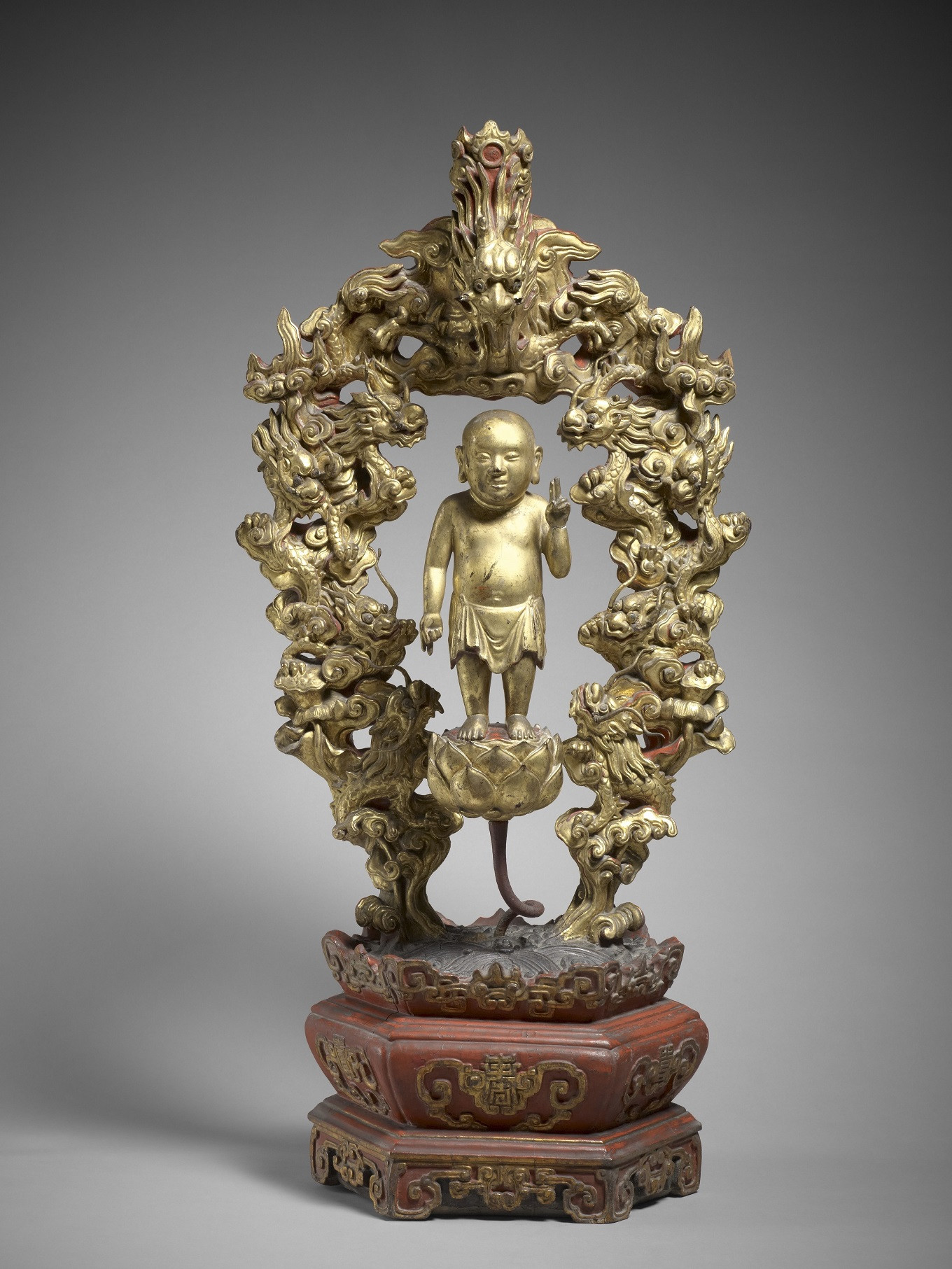 This piece – Siddharta surrounded by nine dragons, Vietnam, Lë Period, end of the 18th century, lacquered and gilded wood, height 105 cm – was donated by Gustave Dumoutier in 1889.