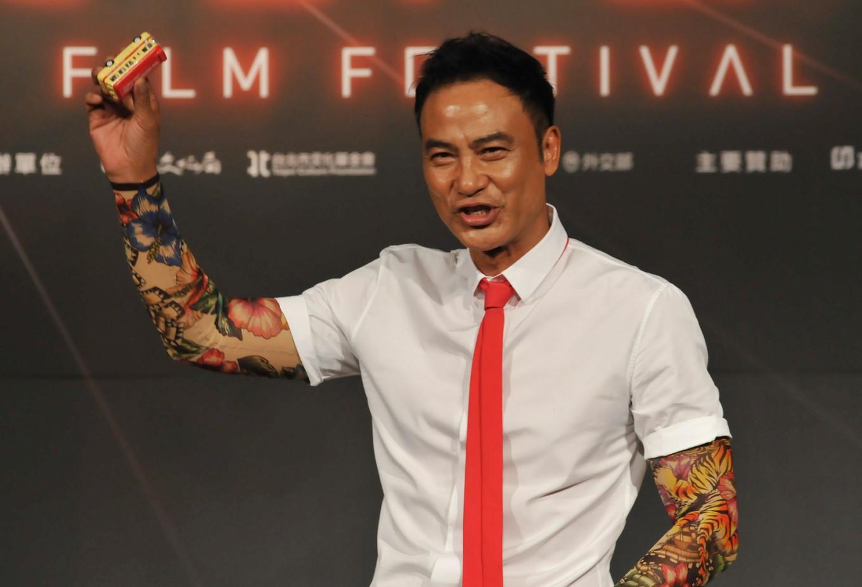 Simon Yam back in Hong Kong after surgery post-attack
