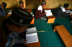 Students chant dzikir and learn about Islam at the boarding school. JP/Aman Rochman