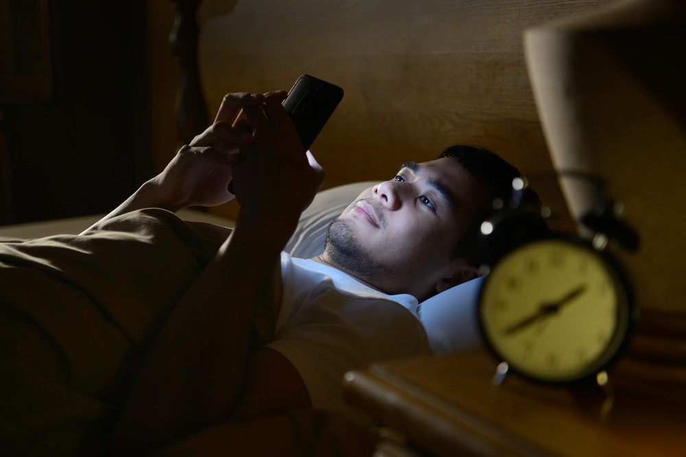 Is checking a smartphone during the night bad for sleep?
