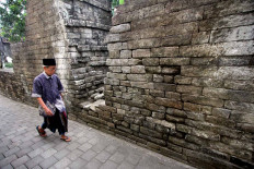 Weathered, but strong: A man walks past the outer walls of the Cepuri Fortress that stands near the Watu Gilang monument. The fortress dates back more than 500 years to the Mataram Kingdom that preceded the Mataram Sultanate. JP/ Boy T Harjanto