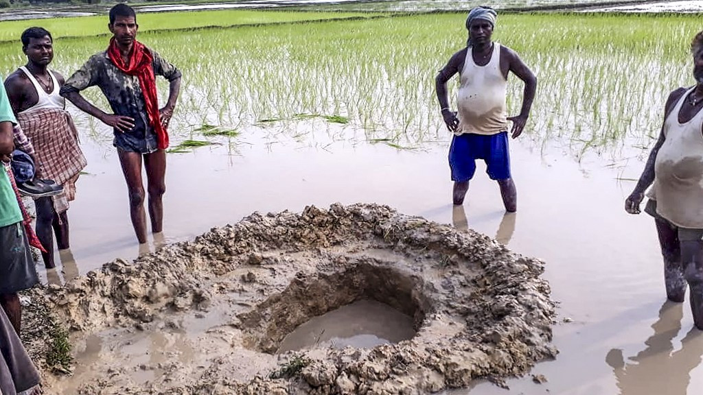 India farmers shocked as meteorite crashes into rice field