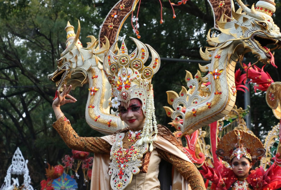 A fashion show of traditional costumes is held during the Solo Batik Carnival.