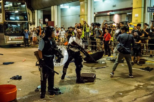 Clashes in Hong Kong after police charge protesters with rioting
