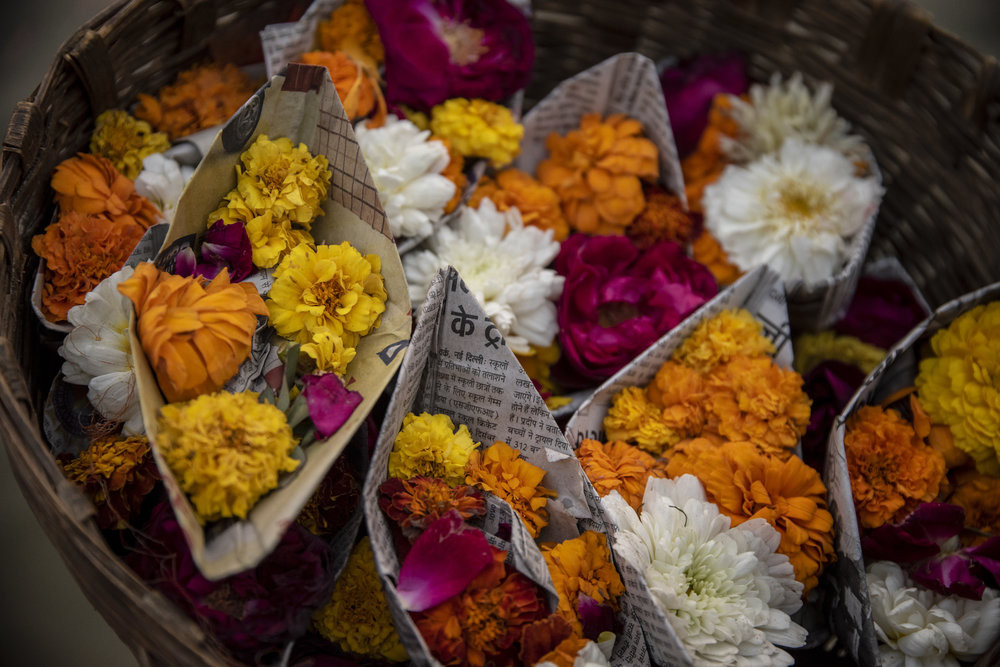 A basket of paper boats filled with Pooja offerings to be sent down the river. JP/Tyler Blodgett