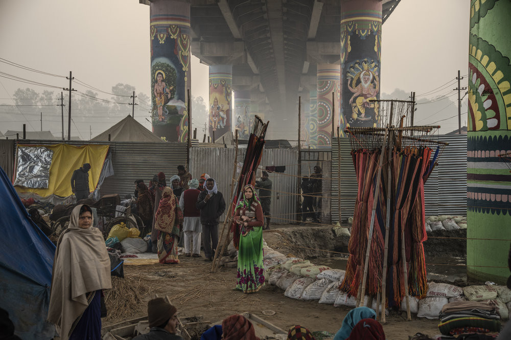 People gather beneath a painted cement bridge within the Mela. JP/Tyler Blodgett