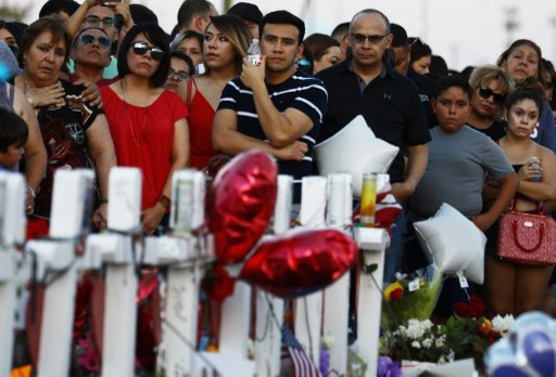 Insight: Between gun massacres, a routine, deadly seven days of US shootings