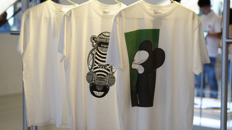 T-shirts are displayed for sale during Oppo's Renoscape exhibition. Proceeds from sales will be donated to Rachel House, a nonprofit organization that provides palliative care for children.