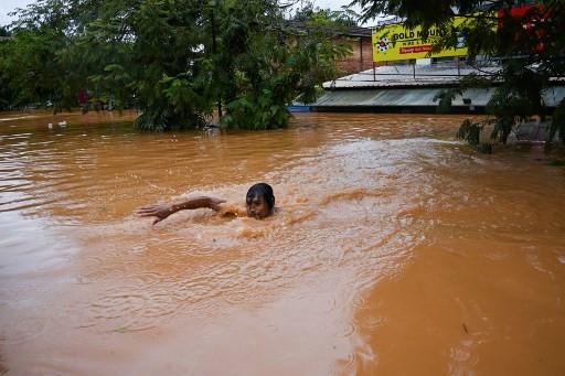 Myanmar troops help flood rescue after landslide kills 51
