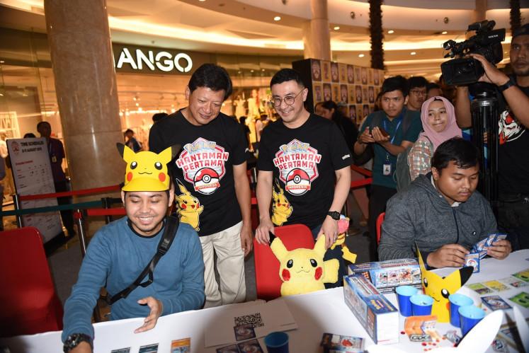 Axton Salim and Kenjiro Ito watch Pokémon Trading Card Game players in action at Grand Atrium - Kota Kasablanka, Jakarta, on Aug. 8