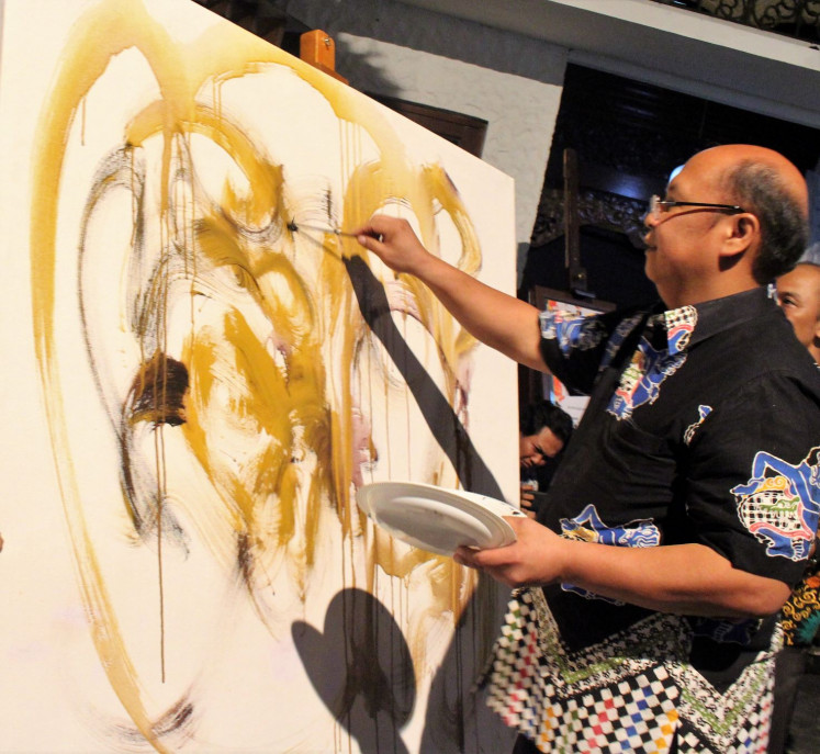 Live: National Police Traffic Corps (Korlantas) traffic safety director Brig. Gen. Chrysnanda Dwi Laksana creates his abstract painting live during the opening of his exhibition in Jakarta.