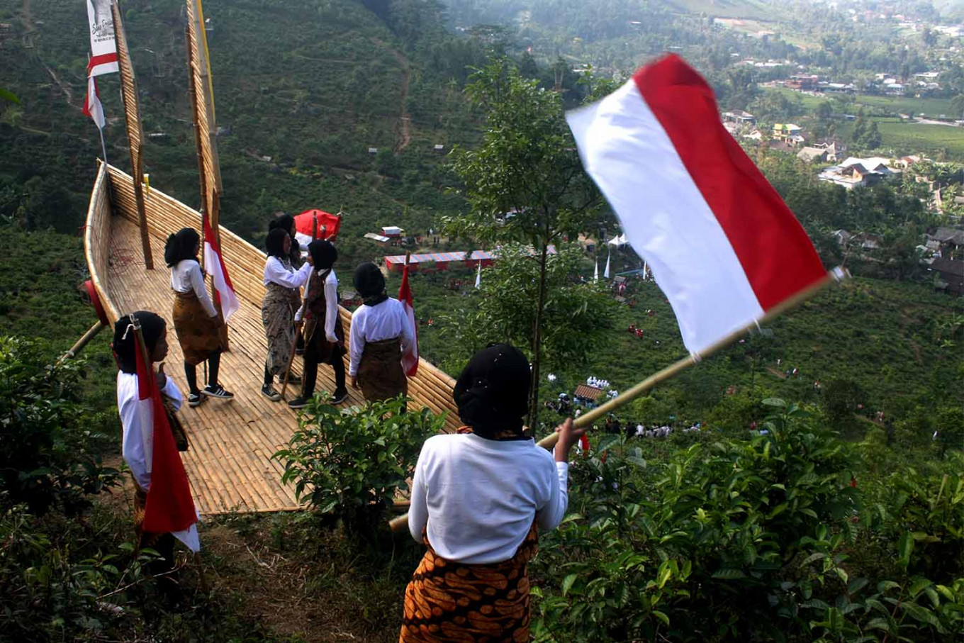 Students of SMP 1 state junior high school in Ngargoyoso carry flags in Sumilir Valley. JP/Maksum Nur Fauzan