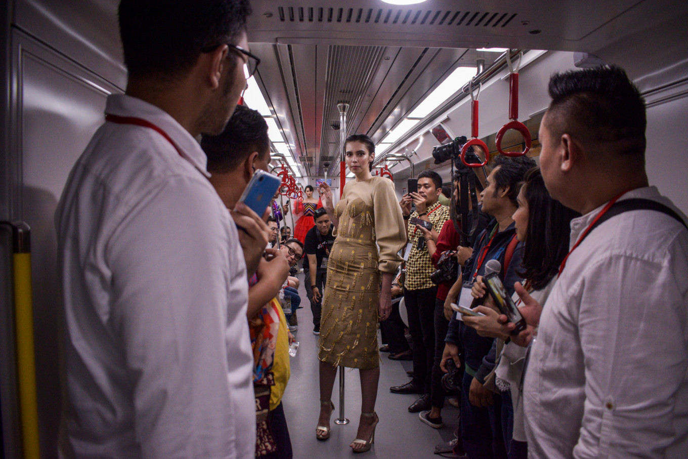 Amid the crowd: A model wears an outfit designed by Yogie Pratama.