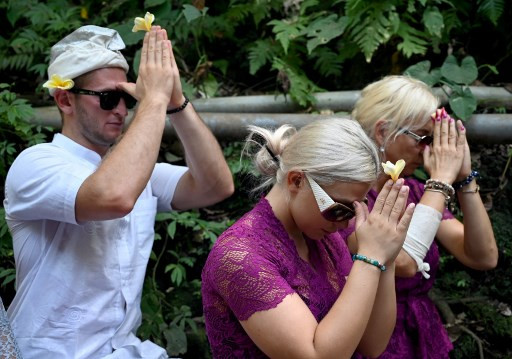 Czech couple pray in cleansing ritual after Bali temple antics