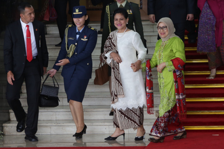 First lady Iriana Joko Widodo (second right) with the Vice President's wife Mufida Kalla (right) leave the Nusantara I building after attending the 2019 State of the Nation address at the House of Representatives complex in Senayan, Jakarta on FRiday.