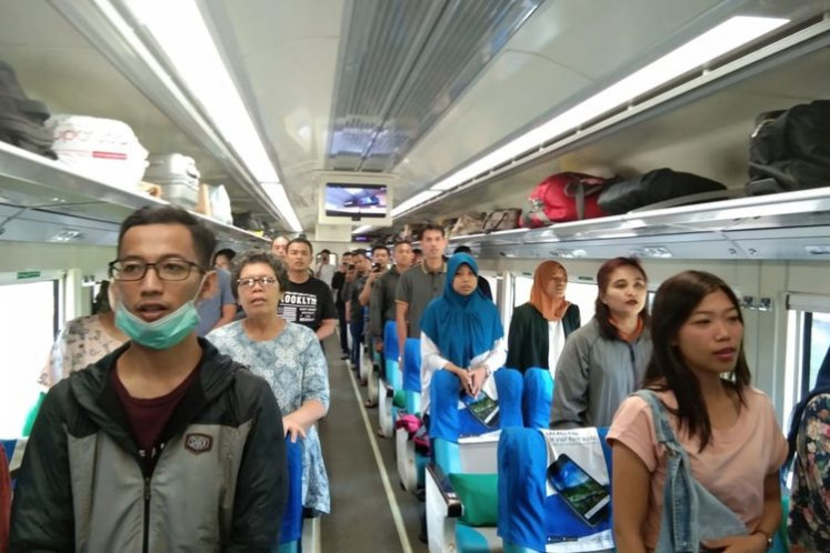 Train passengers sing national anthem to celebrate Indonesia's Independence Day