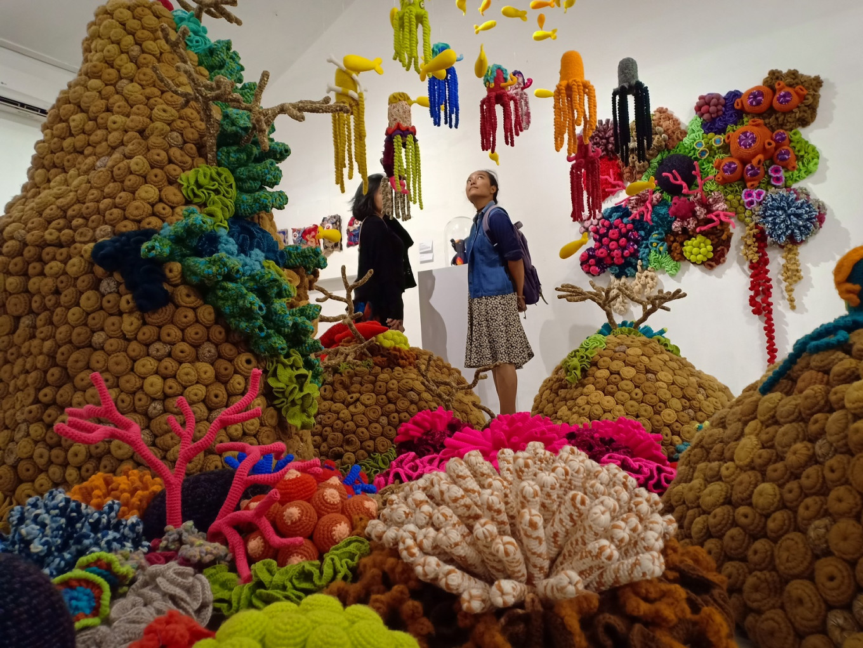 Visitors at Mogus Lab, Yogyakarta, enjoy the artwork of Mulyana.