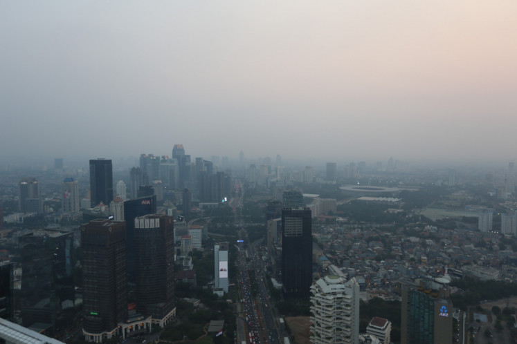 Smog blankets Jakarta's skyscrapers on Aug. 19, 2019. Air pollution in the city is among the worst in the world.