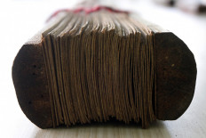 Palm leaf manuscripts are usually put together in bundles using bamboo clips. JP/Arya Dipa