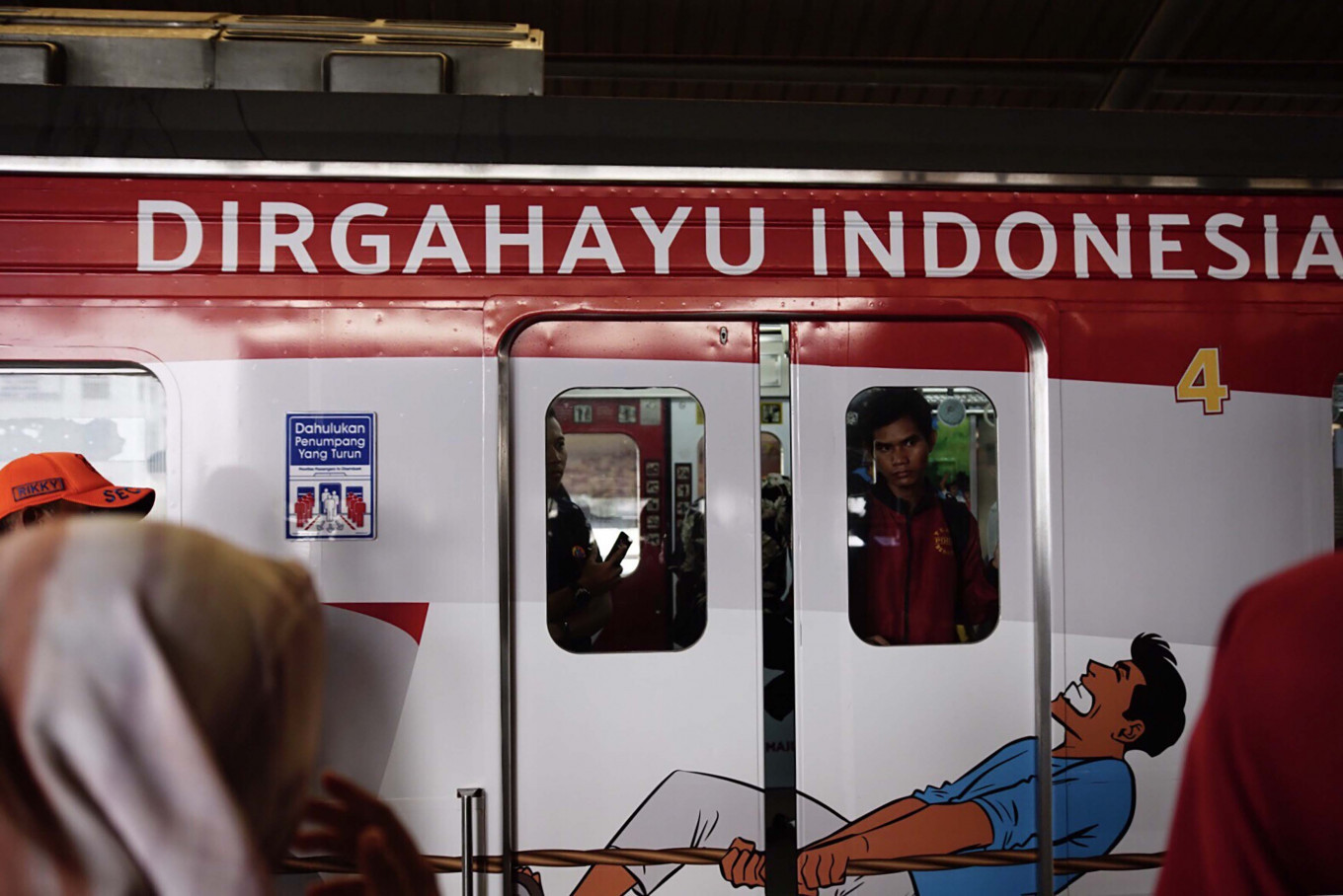 Commuter Line trains painted with the national flag's colors at Jakarta Kota Station, West Jakarta, on Aug. 15. JP/Syelanita