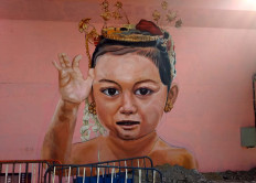 Mural on the south part of the Manahan overpass displays a child character. JP/Ganug Nugroho Adi