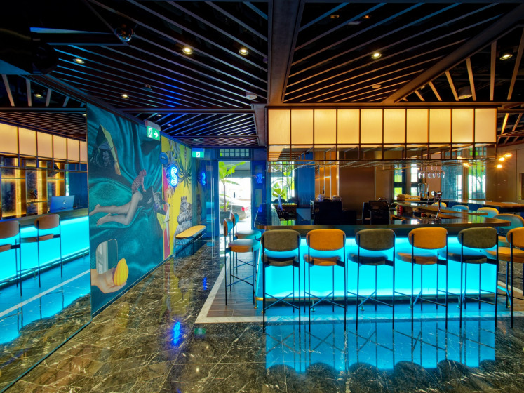 In Hotel Soloha, Singapore, visitors are greeted by a neon jungle decor and vibrant art displays at the reception, which doubles as a Technicolor bar.