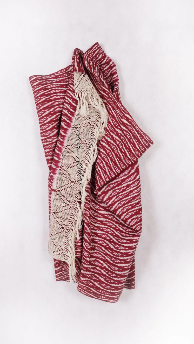 Ecuador's cochineal dyed ikat shawl