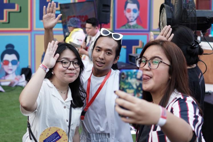 Visitors take a selfie at Playfest 2019.