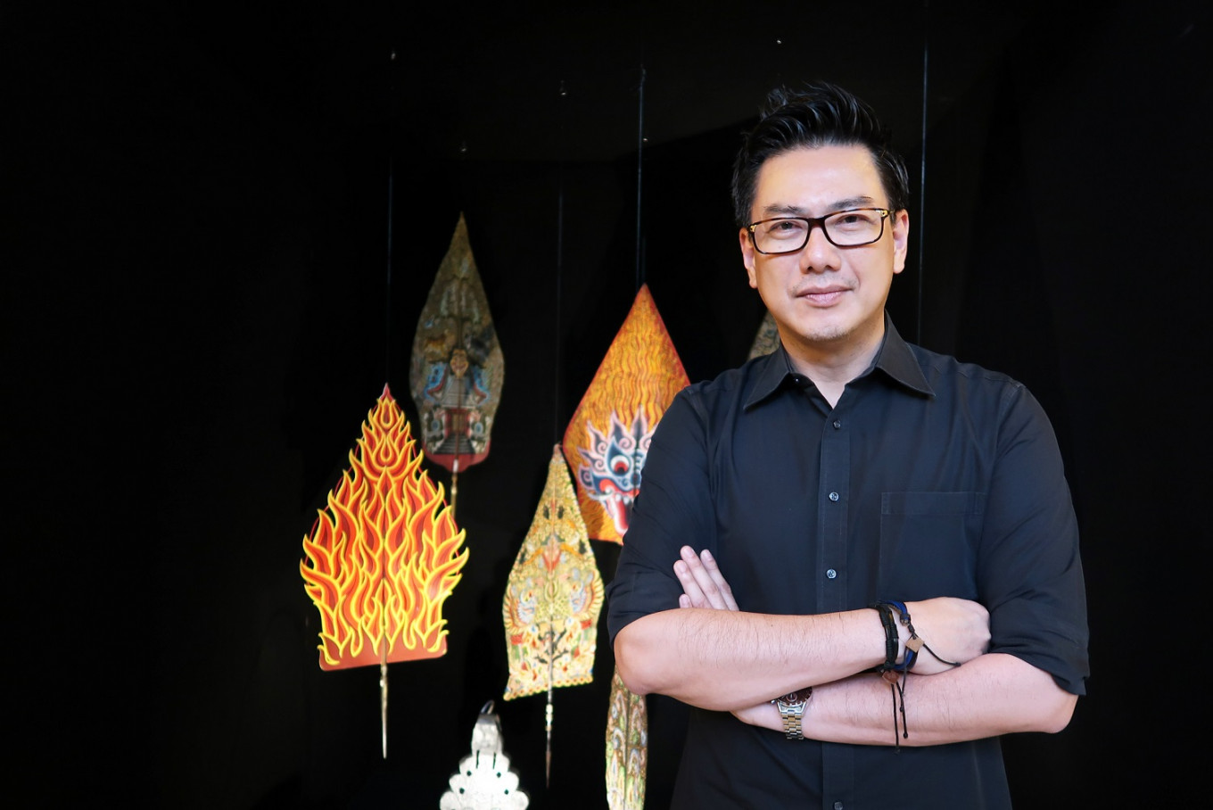 Cosmas Gozali, head of facilities and infrastructure at the Yayasan Mitra Museum Jakarta, poses in front of an item from the 'gunungan' collection.