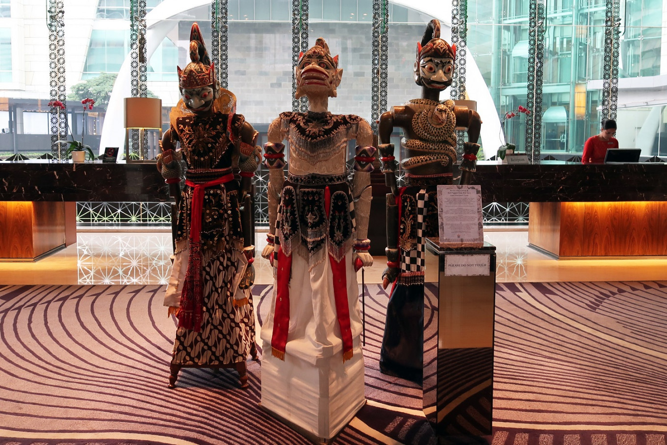 Life-sized 'wayang golek' in the reception area of Hotel Indonesia Kempinski in Central Jakarta.