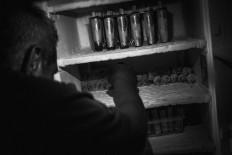 Jumiyo takes ice lollies in various shapes and flavors from his fridge. JP/Anggertimur Lanang Tinarbuko