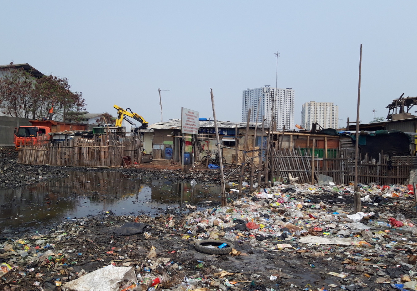 People living side-by-side with trash in North Jakarta kampung