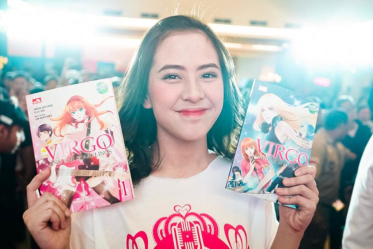 Adhisty Zara, aka Zara JKT48, poses with comic series 'Virgo and The Sparklings' during a press conference on Sept. 7 in Central Jakarta.