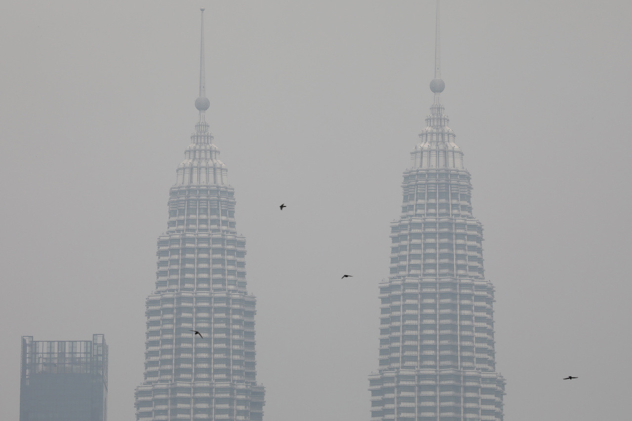 Malaysia sends half a million face masks to haze-hit state as fires burn