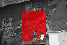 Two children play soccer against the background of a red wall. JP/Boy T Harjanto
